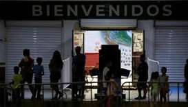 Twelve migrants test positive for coronavirus at Mexican government shelter