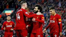 In this February 1, 2020, picture, Liverpool's Mohamed Salah (centre) celebrates their goal with Jor
