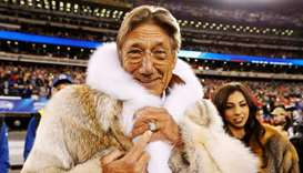 Former New York Jets quarterback Joe Namath points to his championship ring before the Seattle Seaha