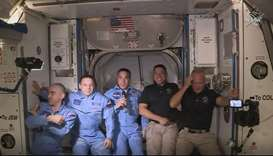 This NASA video frame grab image shows NASA SpaceX's Crew Dragon astronauts Douglas Hurley(R) and Ro