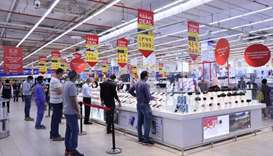 Customers queue at Carrefour's electronics section to buy smartphones during Eid.