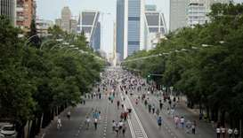 People practice outdoor activities along Paseo de la Castellana avenue amid the coronavirus disease
