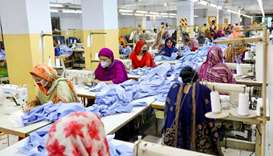 Women work in a garment factory, as factories reopened after the government has eased the restrictio