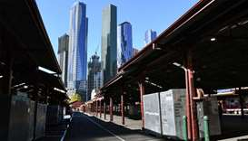 A man (L) walks through a deserted part of Melbourne's Queen Victoria Market