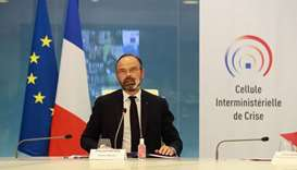French Prime Minister Edouard Philippe takes part in a videoconference with French prefets at the cr