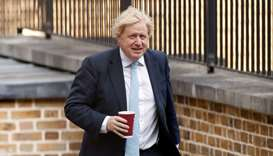 Britain's Prime Minister Boris Johnson arrives at Downing Street, following the outbreak of the coro