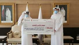 Mohamed Rashid al-Kaabi and Abdullah Sultan al-Qatan at the handover of the cheque