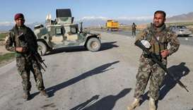 Afghan National Army (ANA) soldiers stand guard at a check point near the Bagram Airbase north of Ka