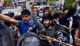 Police detain demonstrators during a protest against India's newly inaugurated link road to the Chin