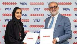 Ooredoo and Visa officials after the signing of the MoU.