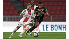 Paris Saint-Germain's Brazilian forward Neymar (left) is challenged by Rennes' French midfielder And