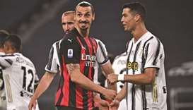 AC Milan's Zlatan Ibrahimovic (centre) and Juventus Cristiano Ronaldo react during the Italian Serie