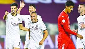 Left: Al Sadd's Santi Cazorla celebrates with teammate Baghdad Bounedjah after scoring a penalty aga