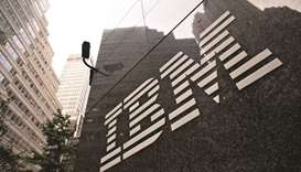 A logo hangs outside the International Business Machines Corp offices in New York. IBM is rolling ou