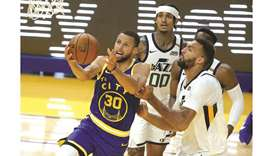 Stephen Curry of the Golden State Warriors is guarded by Rudy Gobert of the Utah Jazz at Chase Cente
