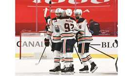 Edmonton Oilers forward Connor McDavid (centre) celebrates with teammates after scoring the winning