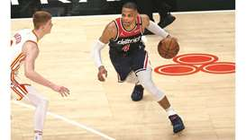 Washington Wizards guard Russell Westbrook is defended by Atlanta Hawks guard Kevin Huerter in the f