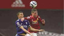 Leicester City's Luke Thomas (left) vies for the ball with Manchester United's Brandon Williams in t