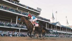 In this file photo taken on May 1, 2021, Medina Spirit, ridden by jockey John Velazquez crosses the