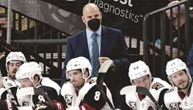 Arizona Coyotes head coach Rick Tocchet handles bench duties in the second period of a game against