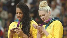 Australia's Liz Cambage (L) and Lauren Jackson look at their bronze medals during the victory ceremo