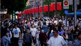 People walk along Nanjing Pedestrian Road, a main shopping area, in Shanghai, China. REUTERS