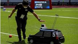 A remote controlled miniature car, developed by Toyota Motor for use in track and field throwing eve
