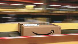 An Amazon Prime parcel passes along a conveyor at an Amazon.com fulfilment centre in Frankenthal, Ge
