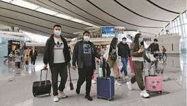 Travellers are seen at the Beijing Daxing International Airport on the first day of Labour Day holid