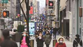 People walk on a busy 5th Avenue in midtown Manhattan in New York City. US consumer prices increased