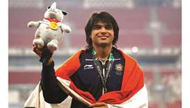 Gold medallist Neeraj Chopra of India poses on the javelin throw podium of the 2018 Asian Games in J