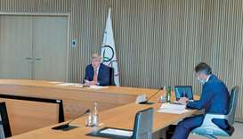 International Olympic Committee (IOC) President Thomas Bach (left) opens the Executive Board virtual