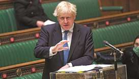 A handout photograph released by the UK Parliament shows Britain's Prime Minister Boris Johnson upda