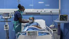Critical care nurse fits a ventilator mask during a simulation to demonstrate delivery of medical ox