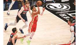 Hawks and Knicks clinch playoff spots, Lakers edge closer