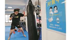 Arisa Tsubata, 27, a nurse and a boxer, trains at a gym inside a psychiatric clinic where she works
