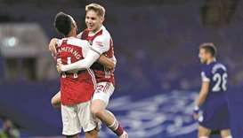 Arsenal's Emile Smith Rowe (right) celebrates with Pierre-Emerick Aubameyang after scoring against C