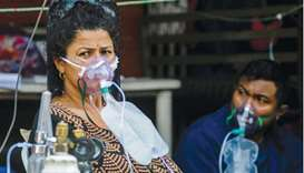 Covid-19 coronavirus patients breathe with the help of medical oxygen outside an emergency ward as t