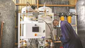 A plant technician installs the final phase of a newly commissioned domestic oxygen plant that will