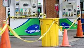 Gas pumps are roped off with a tape indicating a lack of gasoline at a gas station in Washington, US