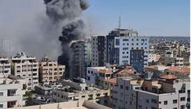 Gaza tower housing Al Jazeera, AP is seen during a missile strike in Gaza city, May 15, 2021.