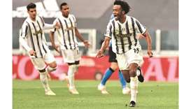 Juventus' Juan Cuadrado celebrates after scoring against Inter Milan during the Serie A match in Tur