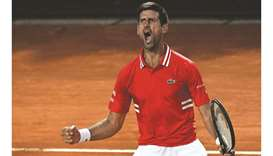 Serbia's Novak Djokovic celebrates a point during the Italian Open semi-final against Italy's Lorenz