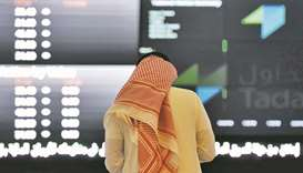 A Saudi investor monitors share prices at the Saudi Stock Exchange, or Tadawul (file). Nomu, the Sau