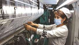 An employee works at a textile factory in Lianyungang, in China's eastern Jiangsu province yesterday