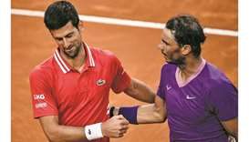 Spain's Rafael Nadal (right) and Serbia's Novak Djokovic greet each other after the former won the I