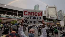 People take part in a protest against the hosting of the 2020 Tokyo Olympic Games in Tokyo