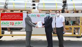 A LuLu Hypermarket Group official hands over the relief materials to the ICBF.