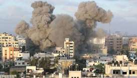 Smoke rises following an Israeli air strike on a building, amid a flare-up of Israeli-Palestinian fi