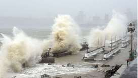 Waves lash over onto a shoreline in Mumbai as Cyclone Tauktae, packing ferocious winds and threateni